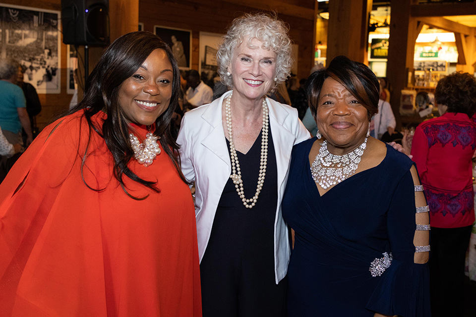 Ruth Graham in picture with two attendees
