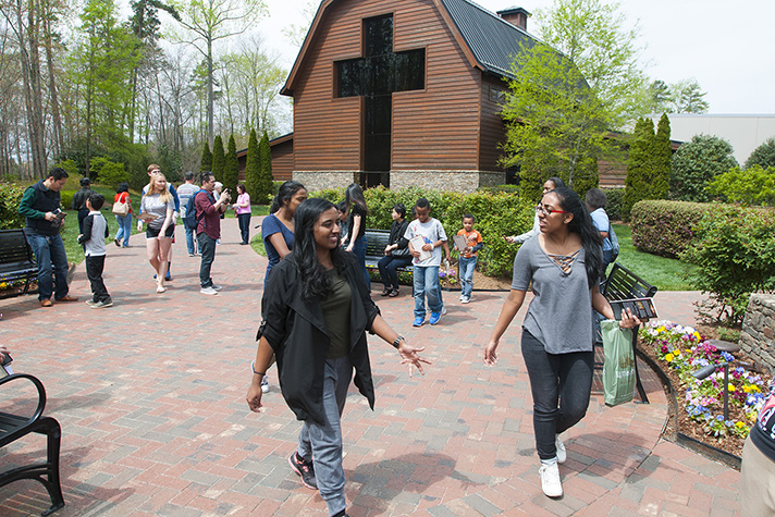 People walking outside the Billy Graham Library