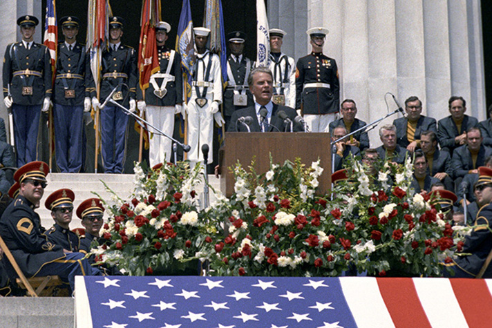 Billy Graham, military personnel at Lincoln Memorial, giant American flag