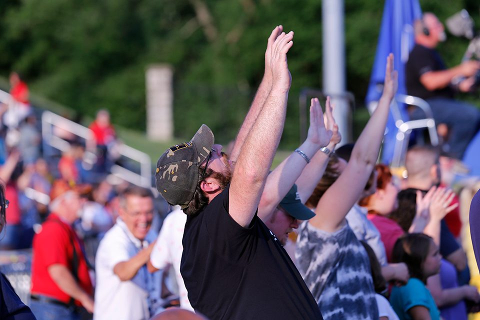 A man with his hands raised worshipping