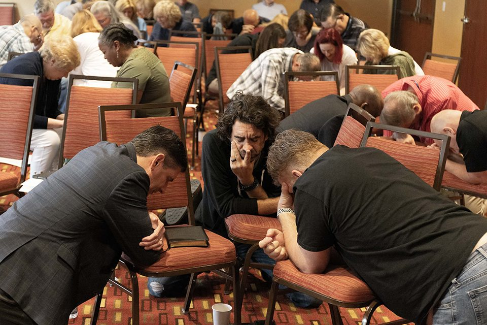 Will Graham praying with other men