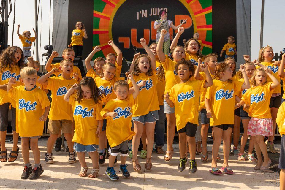 Kids at KidzFest jumping
