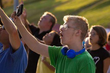 boy holding cellphone
