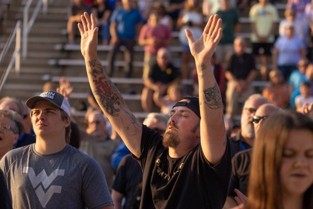 Man raising hands in worship