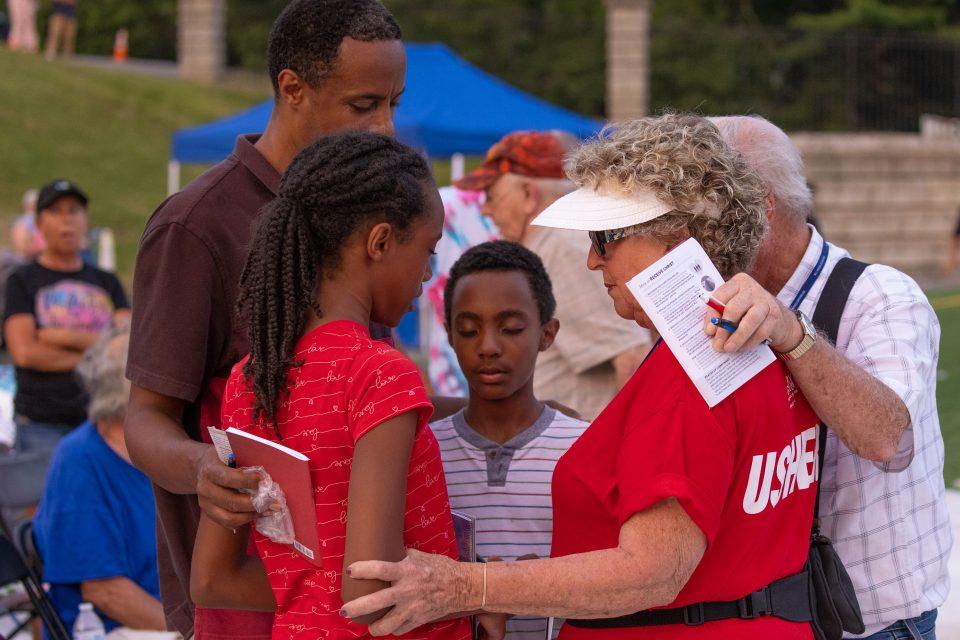 Family and prayer volunteer praying