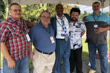 Pastor Mike standing with other pastors