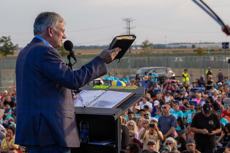 Franklin Graham preaching with Bible