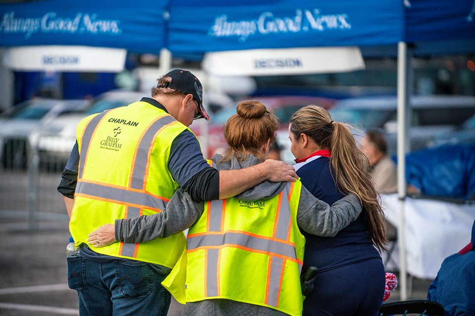 Billy Graham chaplains pray with woman