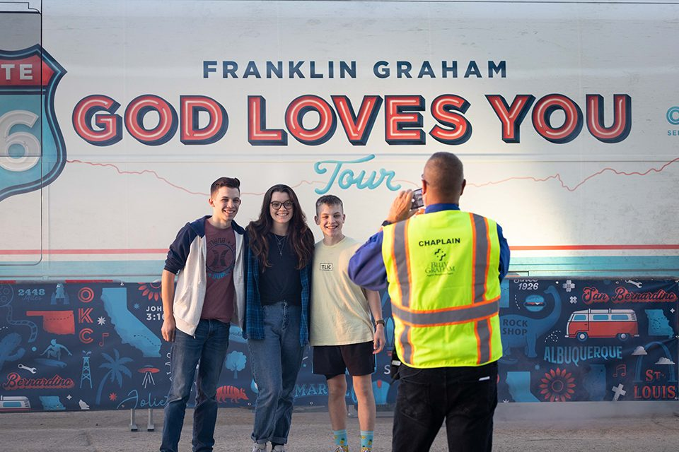 students at God Loves You Tour bus
