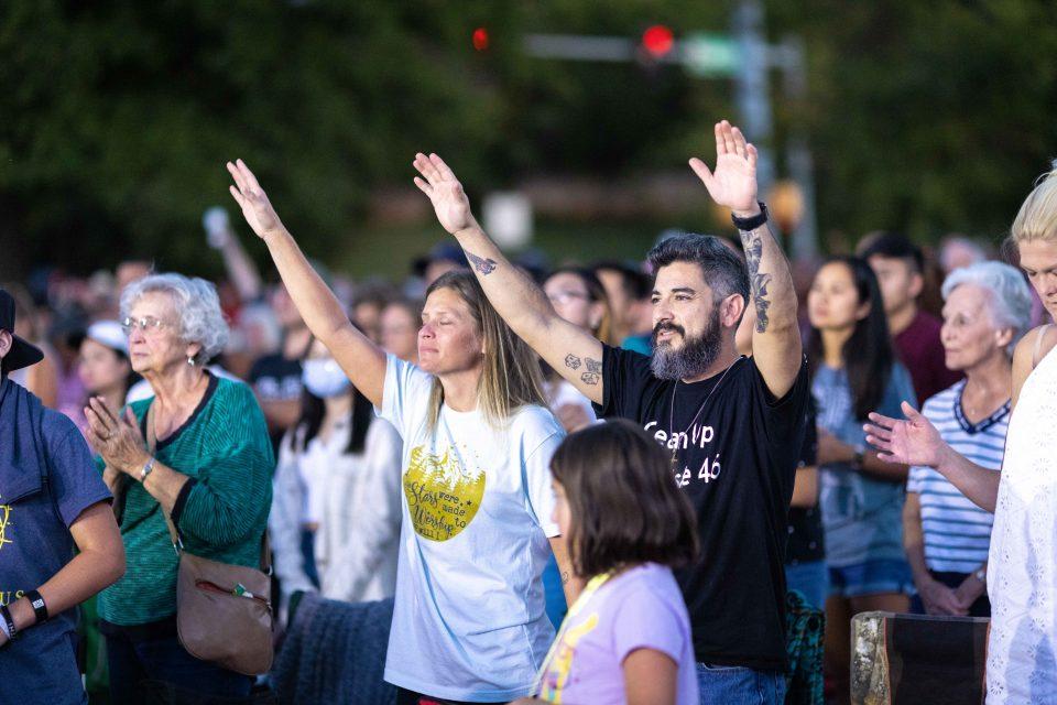 Couple raising hands in worship