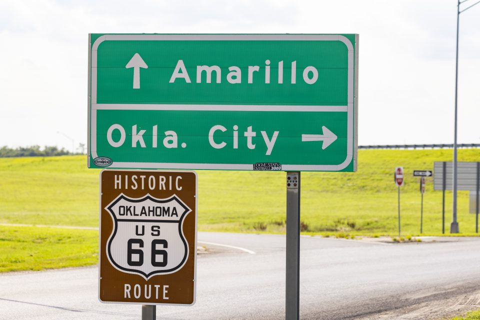 """Road sign with """"Amarillo"""" and """"Oklahoma City"""""""