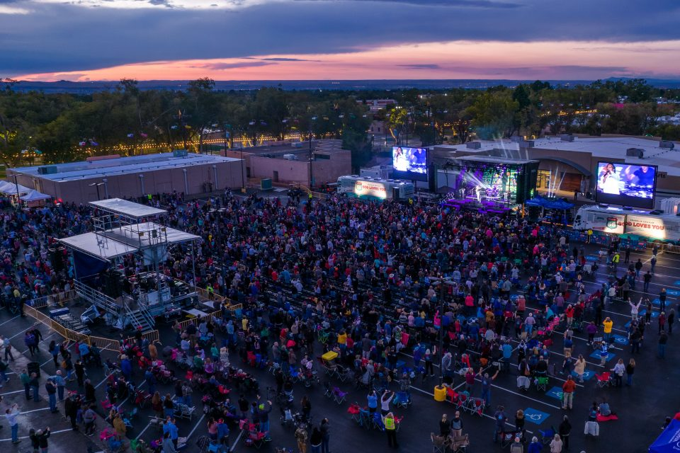Colorful sky; Crowd at Route 66 God Loves You Tour