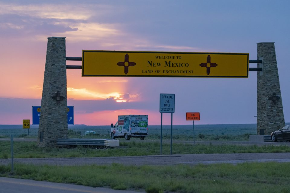 Land of Enchantment road sign at sunset