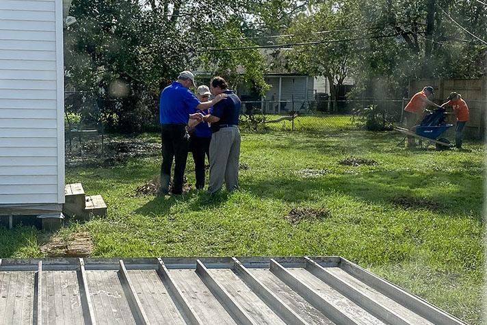Chaplains Paul and Cindy Bernhart pray with Officer Michael Alwert