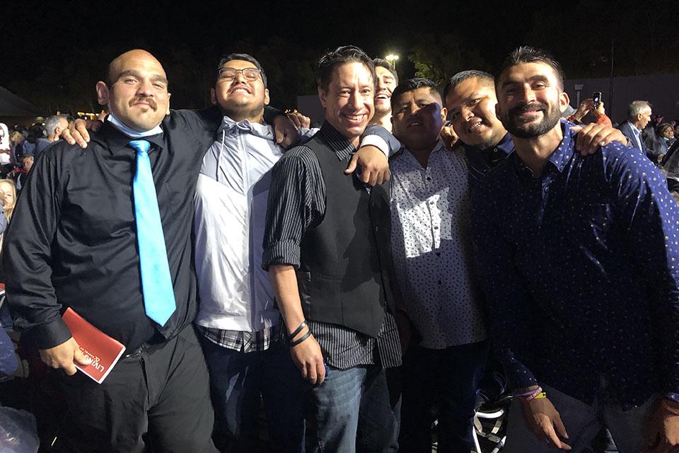 Men smiling, posing for photo