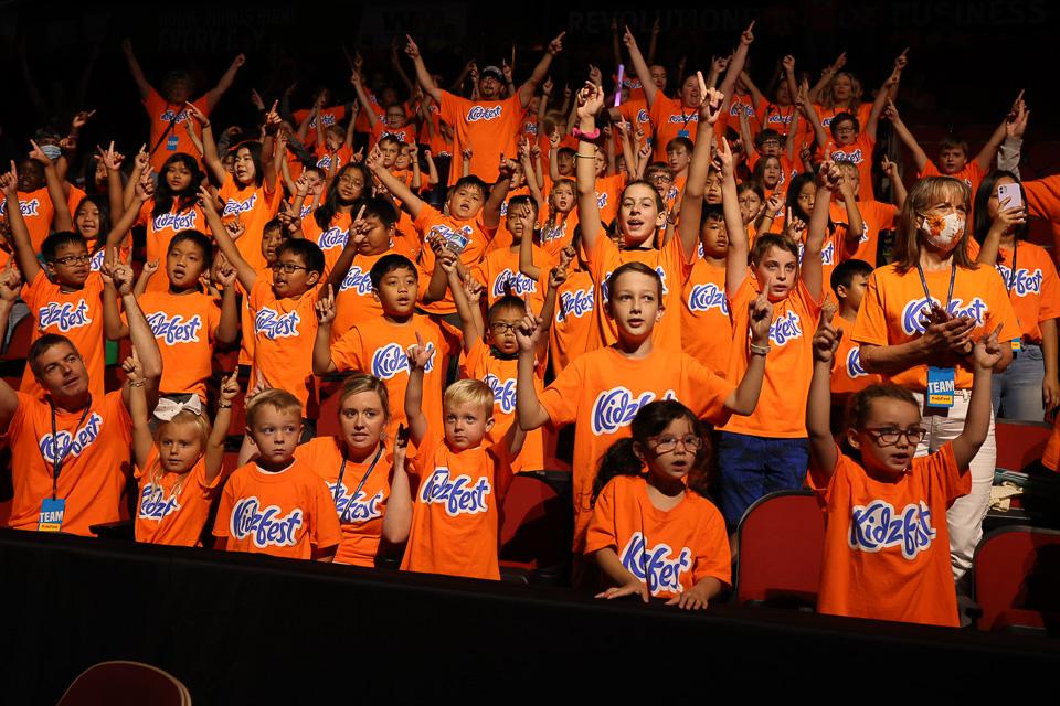 group of children wearing KidzFest shirts