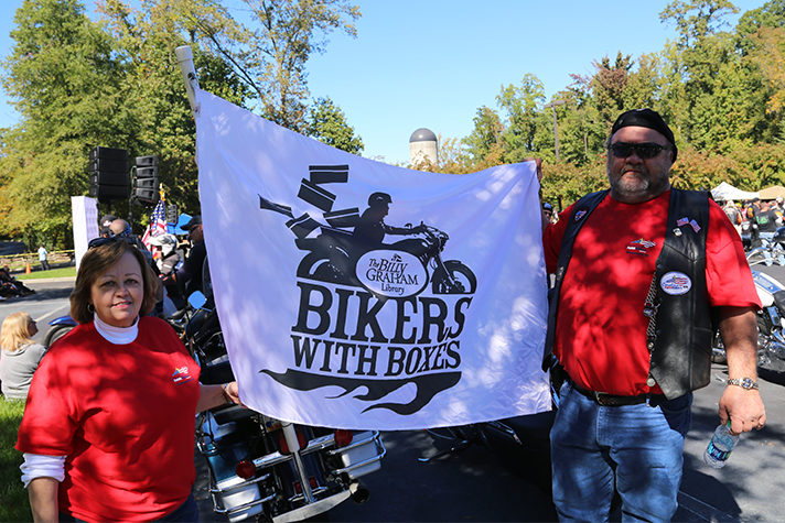 The Rumleys bought this flag from the Billy Graham Library last year. This year, they flew it proudly as they rode from Greensboro to Charlotte for Bikers with Boxes.