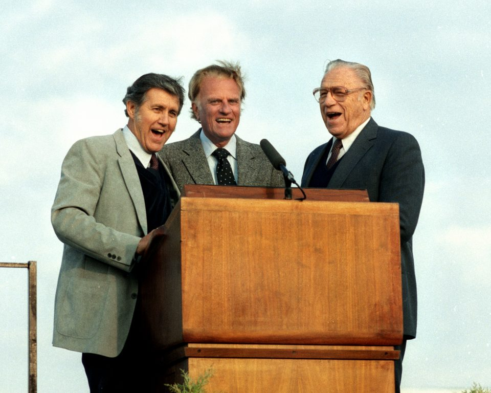 """A candid capture from 1984 of Cliff Barrows (L), Billy Graham and George Beverly Shea (R) singing """"This Little Light of Mine"""" as they sometimes did together. Watch a video of the trio singing."""