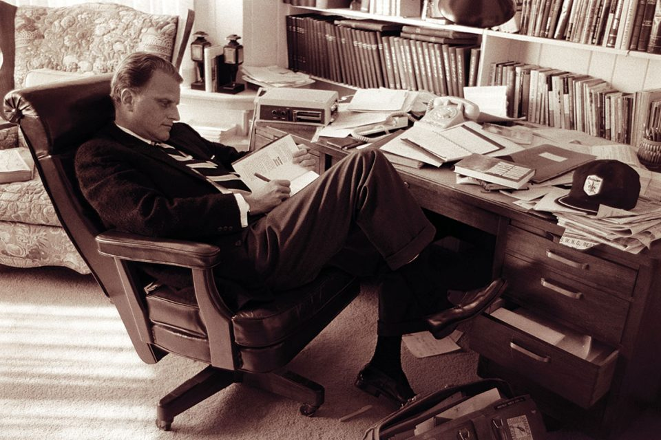 Billy Graham at his desk