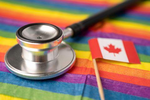 pride flag below canadian flag