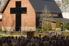 """March 2, 2018: Billy Graham's immediate family escorts his casket to a tent outside the Billy Graham Library in Charlotte—symbolic of the """"canvas cathedral"""" in which Graham conducted his 1949 Los Angeles Crusade that propelled him to national prominence—for a private funeral service."""