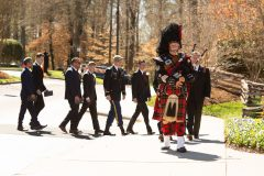 March 2, 2018: As part of Scottish tradition, Pipe Major William Boetticher provides a bagpipe escort for the Graham family at the end of the funeral service. The 2007 funeral for Graham's wife, Ruth, also included a bagpipe recessional.
