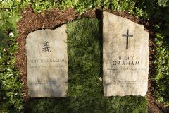 """March 2, 2018: A slab of North Carolina stone marks the grave of Billy Graham, buried next to his wife, Ruth, at the Prayer Garden located next to the Billy Graham Library in Charlotte. The marker inscription bears the text, """"Preacher of the Gospel of the Lord Jesus Christ"""" with the Scripture reference, John 14:6."""