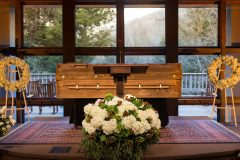 Feb. 23, 2018: The body of Billy Graham—in a simple casket made of pine—rests behind a pulpit at The Billy Graham Training Center at The Cove in Asheville, N.C. The family felt the casket's placement was fitting since Graham spent most of his life preaching the gospel from behind a pulpit.
