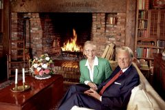 "Billy and Ruth Graham at home in 1993. The German inscription on the fireplace mantel is the title of the famous hymn, ""A Mighty Fortress Is Our God."""