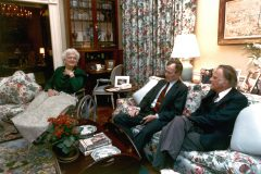 In 1991, Billy Graham visits President George H.W. Bush and his wife Barbara at the White House.