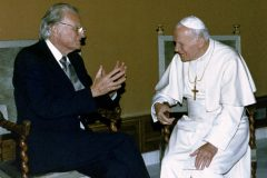 "Billy Graham speaks with Pope John Paul II in 1993. After their first meeting in 1981, Graham had said ""after only a few minutes, I felt as if we had known each other for many years."""