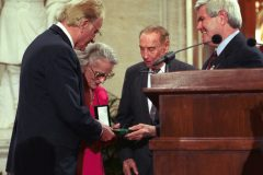 Speaker of the House Newt Gingrich presents Billy and Ruth Graham with the Congressional Gold Medal (the highest honor Congress can bestow on a private citizen) on May 2, 1996. Graham was the first clergyman to receive the honor for ministry.