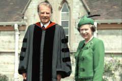 Billy Graham stands with Queen Elizabeth II in 1989. The Queen invited Graham to preach to the royal family at Windsor and Sandringham on multiple occasions.
