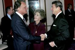 Billy Graham greets President and Nancy Reagan at the National Prayer Breakfast in Washington (February 1981).