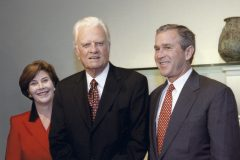 In 2000, Billy Graham meets with President George W. and First Lady Laura Bush.