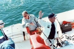 Billy Graham fishes with President George H.W. Bush off the coast of Maine during the early 1990s.