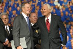 President George H.W. Bush joins Billy Graham at an October 2002 Crusade in Dallas.