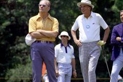 Present Gerald Ford and Billy Graham take in a round of golf at a 1974 pro-am tournament in Charlotte, North Carolina.