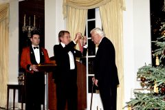 Dec. 6, 2001: British Ambassador Sir Christopher Meyer awards Billy Graham honorary knighthood on behalf of Queen Elizabeth at an embassy ceremony in Washington. Graham received the Honorary Knight Commander of the Order of the British Empire for his international contribution to civic and religious life for more than 60 years.