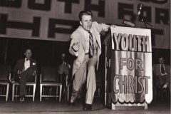 Billy Graham begins his public ministry with the Youth for Christ organization in 1945.