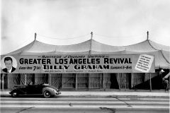"Between Sept. 25 and Nov. 20 of 1949, some 350,000 people gather under a huge tent—often called a ""canvas cathedral""—in Los Angeles to hear Billy Graham preach."