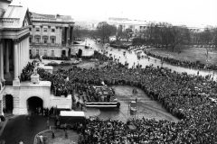 In an unprecedented act of Congress, Billy Graham is allowed to hold a service from the steps of the U.S. Capitol on Feb. 3, 1952. Thousands stand in the rain to hear him preach.