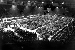 During the 1954 Crusade in North London, Billy Graham preaches to overflow crowds at the 1,200-seat Harringay Arena for nearly three months.