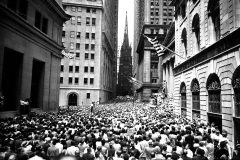 During a lunch-hour meeting in the financial district of Manhattan on July 10, 1957, Billy Graham preaches from the steps of Federal Hall to a crowd of professionals standing shoulder-to-shoulder on Wall Street.