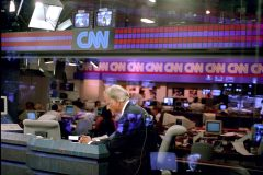 "Billy Graham prays before a 1993 CNN interview, an act common in his preparation for public speaking. ""I am convinced that God has used the press and TV coverage in our work,"" Graham said in ""Billy Graham: God's Ambassador."""