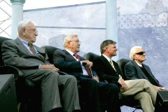 In July 2006, Billy Graham (far right) participates in the Metro Maryland Franklin Graham Festival in Baltimore, along with (left to right) George Beverly Shea, Cliff Barrows and his son Franklin.