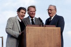"Cliff Barrows, Billy Graham and George Beverly Shea (l to r) sing ""This Little Light of Mine"" at a 1984 Crusade in Sunderland, England. Barrows, Graham and Shea had worked together in ministry since the 1940s."