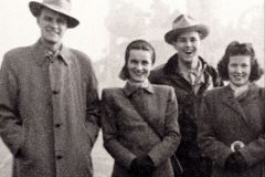 From October 1946 to March 1947, Billy Graham and Cliff Barrows (center right) hold 360 meetings in 27 cities and towns across war-torn Great Britain. Their respective wives, Ruth Graham (center left) and Billie Barrows (far right), joined them for part of the trip.