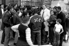 While in New York for his 1957 Crusade, Billy Graham speaks with gang leaders in Spanish-speaking Harlem. The meeting was coordinated by Jim Vaus, former associate of crime boss Mickey Cohen, who began a ministry to reach New York gang members after putting his faith in Christ at Graham's Los Angeles Crusade in 1949.