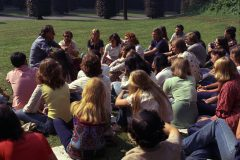 Billy Graham answers questions from a group of young people in Brussels during Eurofest '75, an intensive evangelism training conference that draws tens of thousands of young people from across Europe.